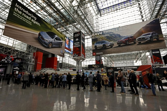 Media and car industry people queue up to attend the New York International Auto Show at the Jacob K. Javits Convention Center in New York City on April 17, 2019. The 2021 show was canceled due to COVID-19. File Photo by Peter Foley/UPI