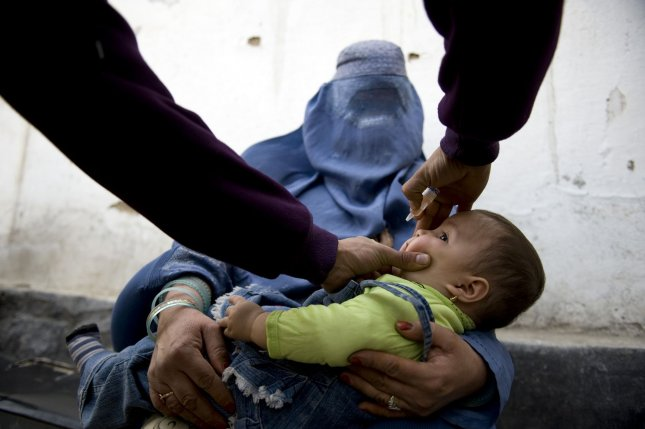 An Afghan child receives an oral polio vaccine on the second day of a vaccination campaign in Kabul, March 15, 2010. A three-day nationwide polio eradication signature project is a joint initiative implemented by the Public Health Ministry, the United Nations Children's Fund (UNICEF) and the World Health Organization (WHO). Afghanistan is one of only of a handful of countries that still suffers the crippling affects of the polio virus. UPI/Hossein Fatemi