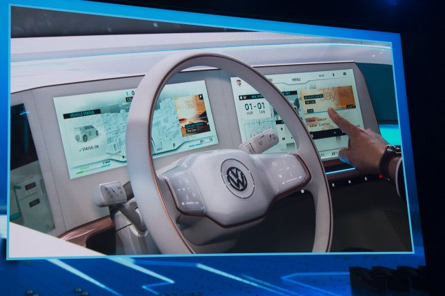 The dashboard of the Volkswagen concept vehicle is projected onto a screen as it is introduced at a 2016 trade show. A survey by J.D. Power and Associates, rating driver-oriented technology in new vehicles, gave top marks to BMW for its Series 2 and Series 4 class cars and to Hyundai for the Tucson and Genesis. Photo by Molly Riley/UPI