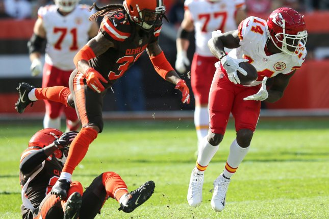 Kansas City Chiefs wide receiver Sammy Watkins (14) makes a catch in front of Cleveland Browns defenders T.J. Carrie and Denzel Rice (37) on Sunday at FirstEnergy Stadium in Cleveland, Ohio. Photo by Aaron Josefczyk/UPI
