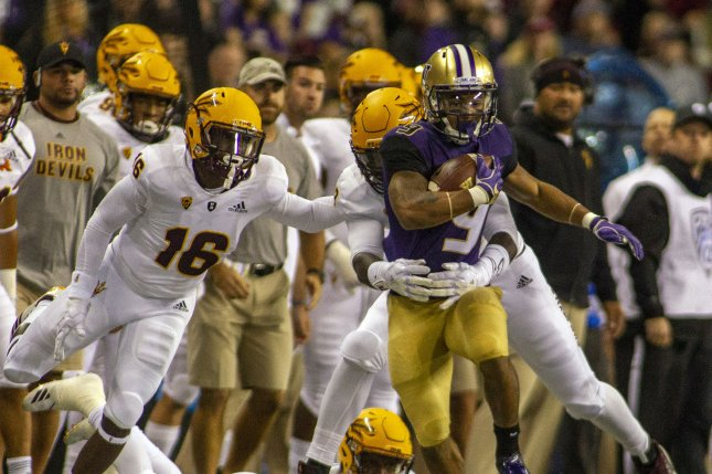 Washington Huskies running back Myles Gaskin (9) is brought down by Arizona State Sun Devils defensive back Chase Lucas (24) after a 9-yard gain during the first quarter on September 22, 2018 at Husky Stadium in Seattle, Washington. Photo by Jim Bryant/UPI