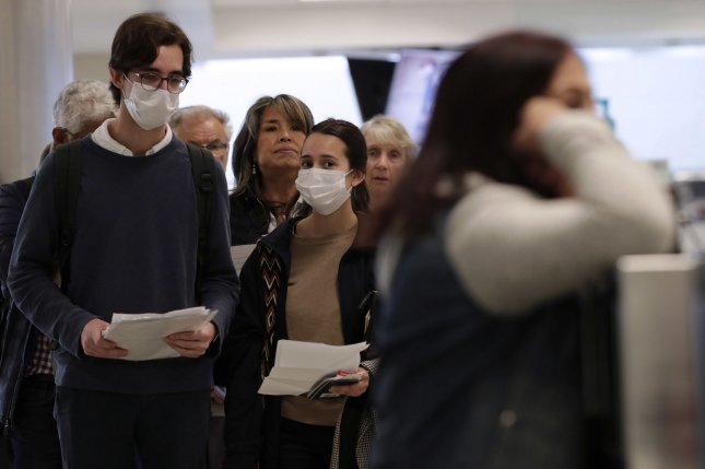 Under the new guidelines, the Transportation Security Administration is asking passengers to wear face coverings during the screening process at airports. File Photo by Glenn Fawcett/U.S. Customs and Border Protection