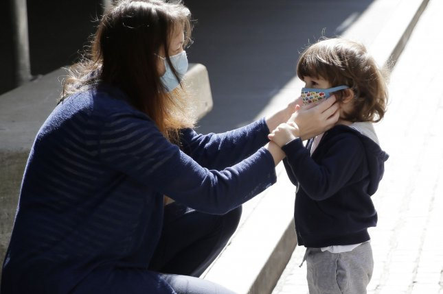 Children 12 and under who are infected with COVID-19 pass the virus to others in their households 53% of the time, according to new CDC data. File Photo by John Angelillo/UPI