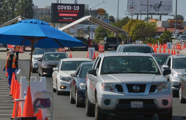 Drivers remain in their vehicles while being monitored to ensure they suffer no adverse reaction to the COVID-19 Moderna vaccine they received at the Forum in Inglewood, Calif., on Saturday. Photo by Jim Ruymen/UPI