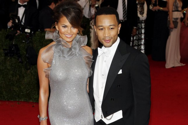 Christine Teigen and John Legend arrive on the red carpet at the Costume Institute Benefit celebrating the opening of Charles James: Beyond Fashion and the new Anna Wintour Costume Center at the Metropolitan Museum of Art in New York City on May 5, 2014. UPI/John Angelillo