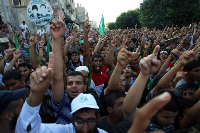 Palestinians chant slogans during a rally in support of the armed Palestinian factions, in Rafah in the southern Gaza Strip August 17, 2014. UPI/Ismael Mohamad