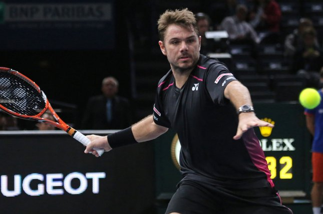 Stan Wawrinka of Switzerland hits a shot during his BNP Paribas Masters second round match against Bernard Tomic of Australia in Paris on November 3, 2015. Wawrinka defeated Tomic 6-3, 7-6 (6) to advance to the third round. Photo by David Silpa/UPI