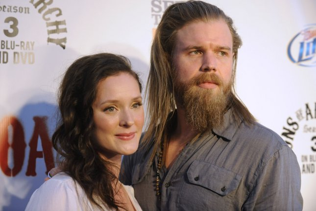 Ryan Hurst (R) and Molly Clarkson attend the Sons of Anarchy Season 4 premiere screening in Los Angeles in 2011. Hurst's new show Outsiders airs on WGN America on Tuesday nights. File Photo by Phil McCarten/UPI