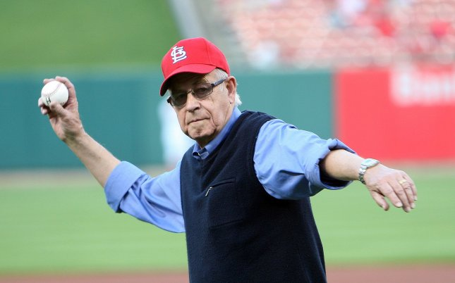 National Public Radio broadcaster Carl Kasell, seen here throwing out the first pitch at a St. Louis Cardinals game in 2010, died at the age of 85 Tuesday following complications from Alzheimer's disease. File Photo by Bill Greenblatt