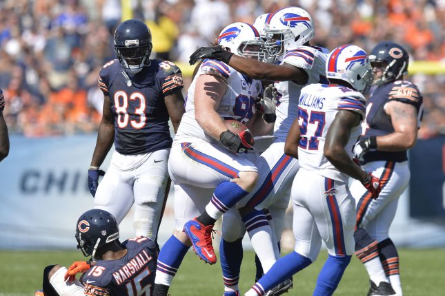 Buffalo Bills defensive tackle Kyle Williams (C) is congratulated by his teammates after intercepting a pass. File photo by Brian Kersey/UPI
