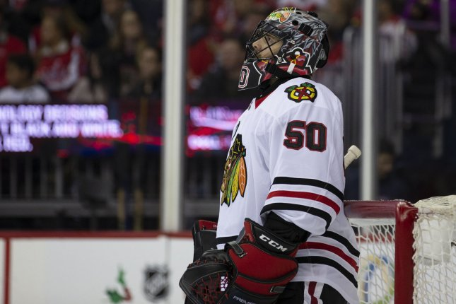 Chicago Blackhawks goaltender Corey Crawford (50) checks the scoreboard after a stoppage in play during the second period on November 21 at Capital One Arena in Washington, D.C. Photo by Alex Edelman/UPI