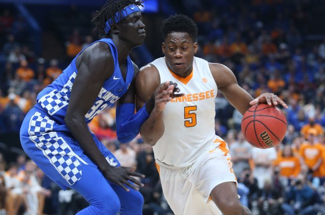 Kentucky defender Wenyen Gabriel tries to slow Tennessee Vols forward Admiral Schofield in the first half of the SEC Championship Game on March 11, 2018 at the Scottrade Center in St. Louis. Photo by BIll Greenblatt/UPI
