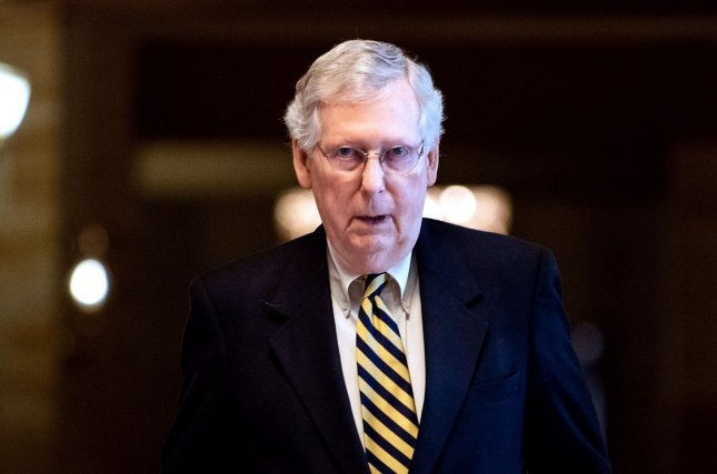 Senate Republican leader Mitch McConnell walks through the hallway on Capitol Hill in Washington, D.C., on Monday after blocking a resolution to make the Robert Mueller report public. Photo by Kevin Dietsch/UPI