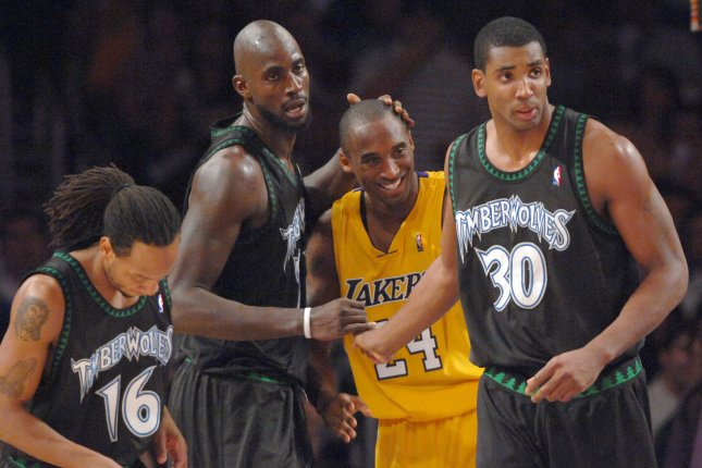 Former Minnesota Timberwolves center Kevin Garnett (2nd from L) had many battles against Los Angeles Lakers star Kobe Bryant (24) during his decorated NBA tenure. File Photo by Jim Ruymen/UPI