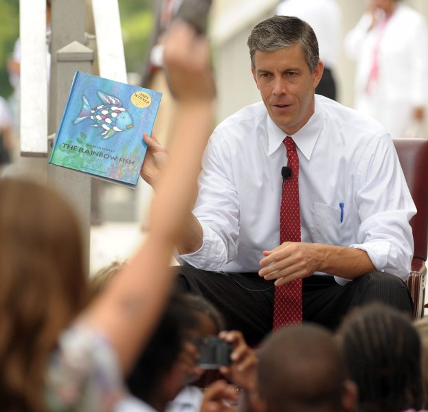 Secretary of Education Arne Duncan reads to children at the Education Department in Washington on July 22, 2009. (UPI Photo/Roger L. Wollenberg)