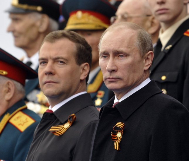 Russian President Dmitry Medvedev (L) and Prime Minister Vladimir Putin attend a military parade in Red Square on the Victory Day in Moscow on May 09, 2011. UPI Photo/Stringer.
