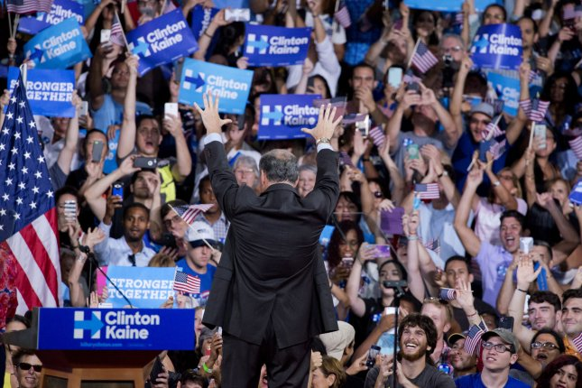 Presumptive Democratic nominee for President of The United States, Hillary Clinton and her pick for Vice President Sen.Tim Kaine cheer with supporters after a rally at Florida International University Arena, Miami, Florida, July 23, 2016. The Democratic National Committee will vote on new rules that would bind two-thirds of superdelegates to state results and allow the other third to vote their choice. Photo by Gary I Rothstein/UPI