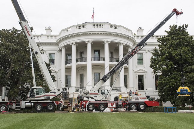 Cranes and construction equipment are seen on the South Lawn as renovations continue at the White House Friday. While President Trump is in New Jersey on a 17-day vacation, workers are updating and repairing the West Wing, including structural repairs, IT and HVAC improvements and generic cosmetic upgrades. Photo by Kevin Dietsch/UPI