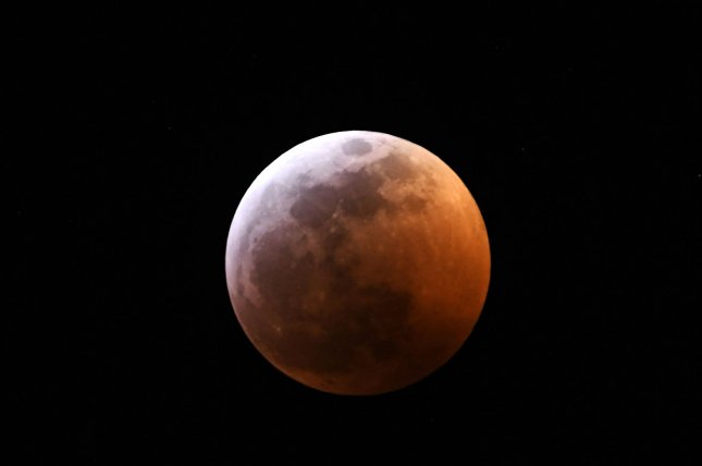 Earth's moon hovers in the skies over Melbourne, Fla., as it is eclipsed through Sunday night and Monday morning. Photo by Joe Marino/UPI