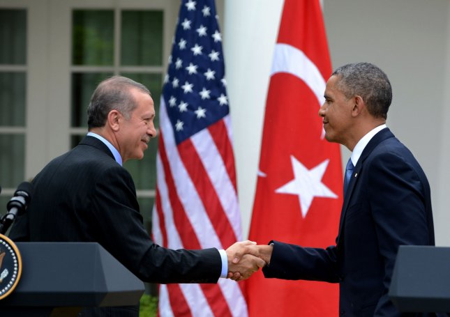 Turkish Prime Minister Recep Tayyip Erdogan (L) and U.S. President Barack Obama shake hands after a joint press conference in Rose Garden of the White House in Washington, DC on May 16, 2013. The American and Turkey flags are in the background. The two world leaders discussed the Syria situation and answered questions on a range of subjects. UPI/Pat Benic