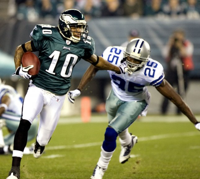 Philadelphia Eagles DeSean Jackson (10) holds off Dallas Cowboys Patrick Watkins (25) as he gains 9-yards on a punt return during second quarter Philadelphia Eagles-Dallas Cowboys game action in Philadelphia at Lincoln Financial Field November 8, 2009. UPI/John Anderson