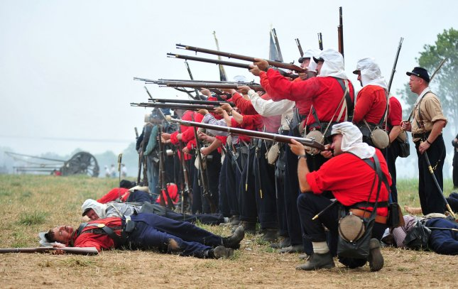 Union soldiers takes aim during the reenactment of the Battle of Bull Run at Brawner Farm in Manassas, Virginia on July 24, 2011. This event marked the 150th anniversary of the the first major battle of the Civil War. UPI/Kevin Dietsch