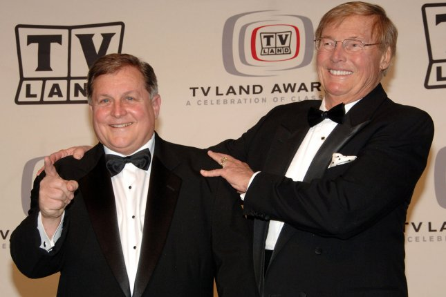 Actors Burt Ward (L) and Adam West, stars of the classic television show Batman, appear backstage after receiving the award honoring the show's 40th anniversary during a taping of the fourth annual TV Land Awards show on March 19, 2006. The pair are set to reprise their roles in a new animated feature entitled Batman: Return of the Caped Crusaders. File Photo by Jim Ruymen/UPI