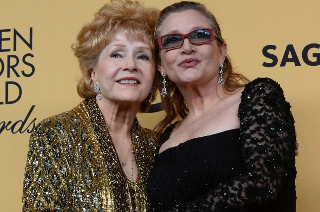 Debbie Reynolds, 84, died in Los Angeles on December 28, one day after her daughter Carrie Fisher (R) died. Fisher, 60, reportedly had a massive heart attack on a flight from London to Los Angeles on Dec. 23. The two are shown above in January 2015 when Debbie Reynolds received the Screen Actors Guild Lifetime Award. File Photo by Jim Ruymen/UPI