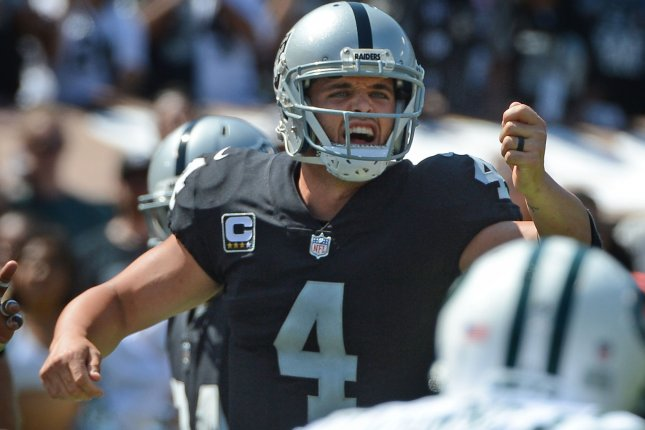 Oakland Raiders QB Derek Carr changes the play against the New York Jets in the first quarter on September 17 at the Coliseum in Oakland, Calif. Photo by Terry Schmitt/UPI