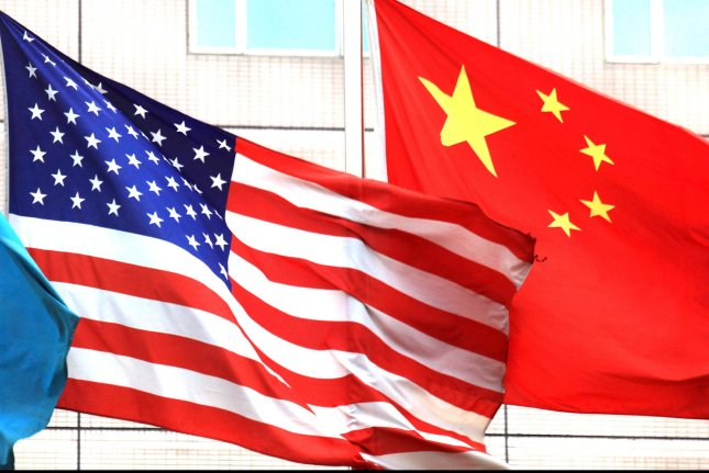A former U.S. intelligence officer was charged by the Justice Department Monday of attempting to sell classified information to the Chinese government. File Photo by Stephen Shaver/UPI