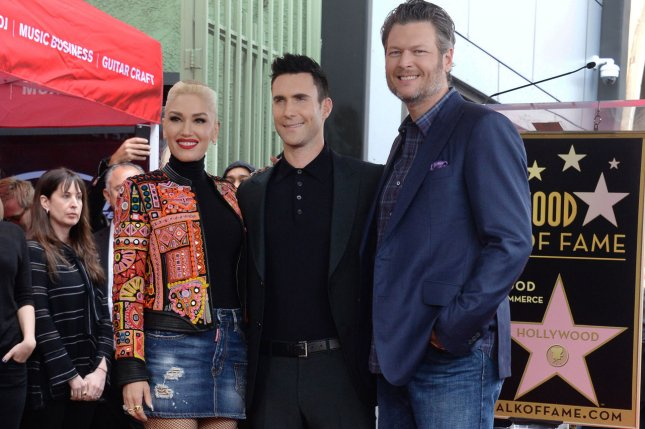Blake Shelton (R), pictured with Gwen Stefani (L) and Adam Levine, dedicated a sweet post to Stefani on her birthday. File Photo by Jim Ruymen/UPI