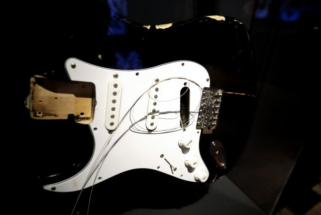 A Stratocaster once owned by Kurt Cobain is on display at a press preview for Play It Loud: Instruments of Rock & Roll at the Metropolitan Museum of Art on April 1. On April 5, 1994, Cobain killed himself at his home in Seattle. He was 27. It would be three days before his body was discovered. Photo by John Angelillo/UPI