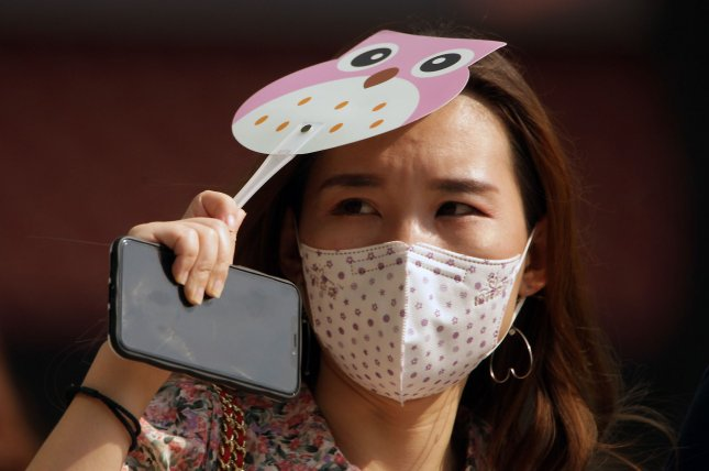 A video recording showed that the 3-ply surgical mask was the most effective, but even a single-layer mask reduced the spread of droplets. Photo by Stephen Shaver/UPI