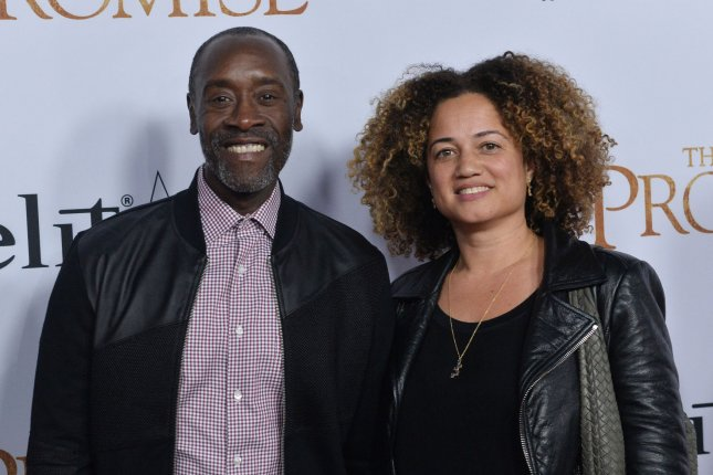 Don Cheadle (L) -- pictured here with Bridgid Coulter -- has joined the reboot of ABC's The Wonder Years. File Photo by Jim Ruymen/UPI