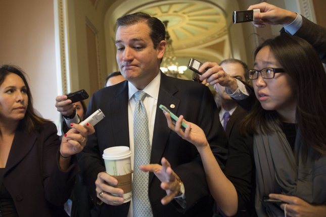 Sen. Ted Cruz (R-TX) talks to reporters outside of the Senate floor on October 16, 2013 in Washington, D.C. UPI/Kevin Dietsch