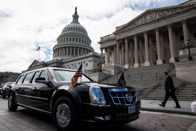 A Secret Service agent buffs the presidential limousine while it is parked outside the U.S. Capitol, in Washington, March 12, 2013. UPI/Drew Angerer/Pool