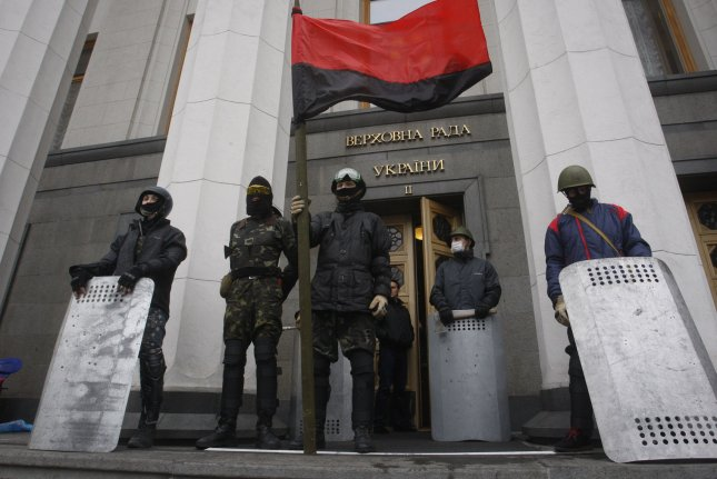 Anti-government protesters stand guard in front of the parliament building in Kiev on February 22, 2014. UPI/Ivan Vakolenko