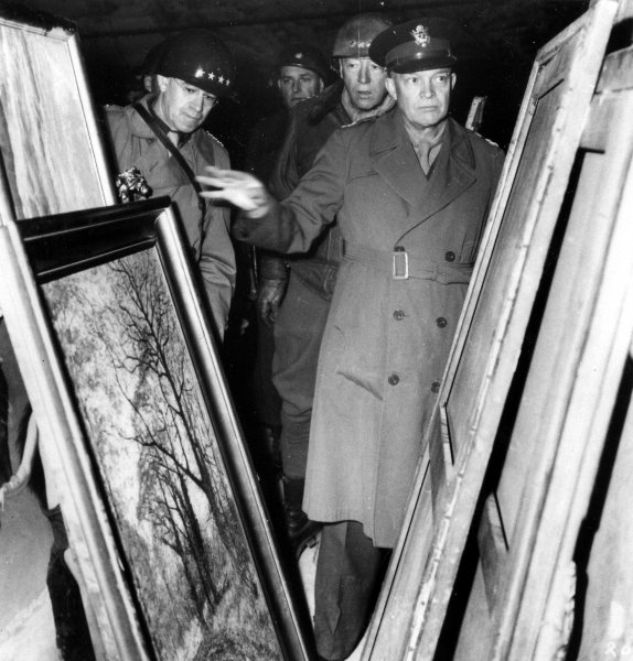 Gens. Omar Bradley (L), George Patton (C) and Dwight Eisenhower inspect art treasures taken by the Nazis and stored in mines in Austria during World War II. (Undated) WHC/UPI