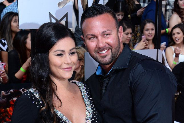 TV personality Jenni 'Jwoww' Farley and Roger Mathews arrive for The MTV Movie Awards at Nokia Theatre L.A. Live in Los Angeles, California on April 13, 2014. UPI/Jim Ruymen