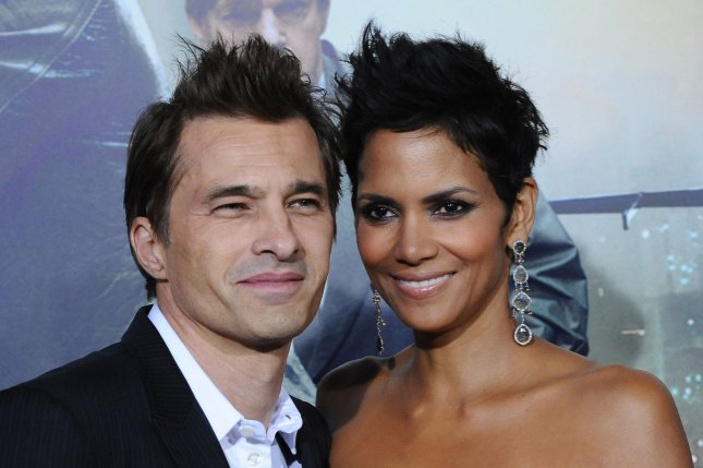 Halle Berry (R) and husband Olivier Martinez at the Los Angeles premiere of 'Cloud Atlas' on October 24, 2012. Sources say the couple are very much together, despite reports. File photo by Jim Ruymen/UPI