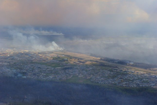 Alberta's government says fires in the Fort McMurray area are still out of control, though energy companies are starting to move employees back to the region to get operations restarted. Photo by MCpl VanPutten/Canadian Armed Forces/UPI