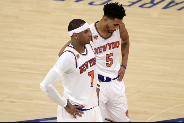 New York Knicks Carmelo Anthony and Courtney Lee stand on the court in the first half against the Indiana Pacers at Madison Square Garden in New York City on December 20, 2016. Photo by John Angelillo/UPI
