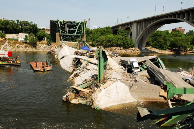 Navy divers from Mobile Diving and Salvage Unit 2 from the Naval Amphibious Base in Little Creek, Va., survey the wreckage of the I-35 Bridge in Minneapolis on August 7, 2007. The bridge collapsed August 1. File Photo by Joshua Adam Nuzzo/U.S. Navy