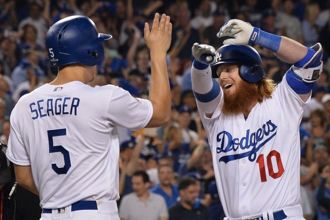 Los Angeles Dodgers' Justin Turner (10) high fives Corey Seager after scoring on a three-run home run against the Arizona Diamondbacks in the first inning during the NLDS Game 1 Friday at Dodger Stadium in Los Angeles, Calif. Photo by Jim Ruymen/UPI