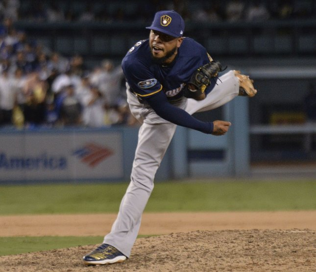 Milwaukee Brewers reliever Jeremy Jeffress pitches out of a bases-loaded jam to beat the Los Angeles Dodgers in NL Championship Series at Dodger Stadium on October 15, 2018 in Los Angeles. Photo by Jim Ruymen/UPI