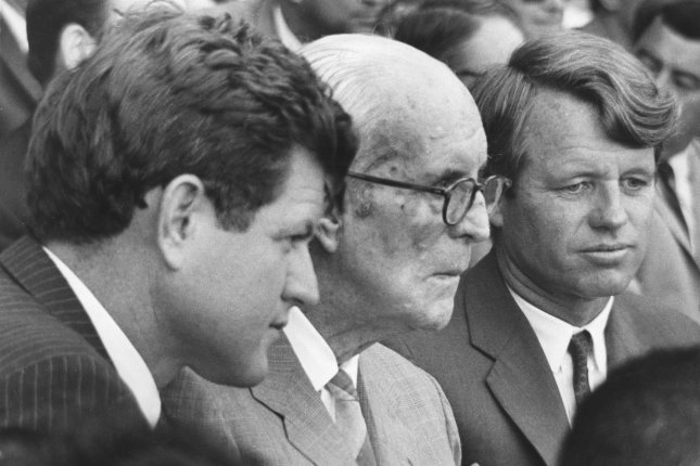 Sen. Edward Kennedy (L) attends the opening baseball game of the world series at Fenway Park in Boston on October 4, 1967, with his father, Joseph P. Kennedy (C), and his brother Sen. Robert F. Kennedy. The elder Kennedy died November 18, 1969. UPI File Photo