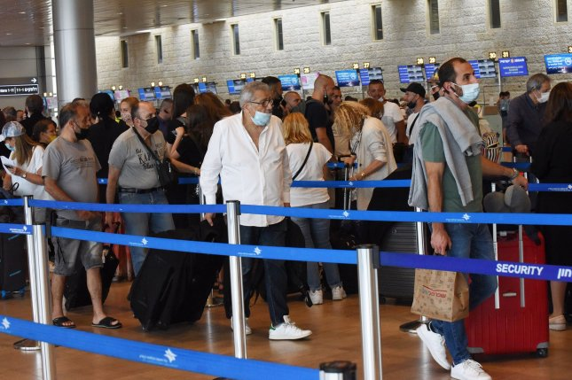 People wait for security checks before checking in for flights at Ben Gurion International Airport in Lod, near Tel Aviv, Israel. File Photo by Debbie Hill/UPI
