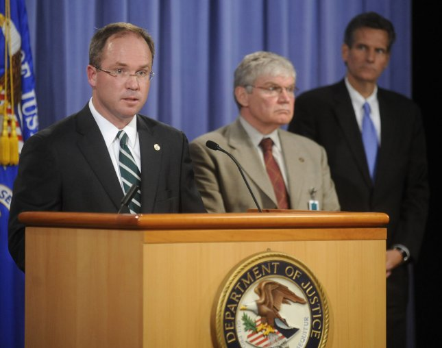 Jeffrey Taylor (L), U.S. Attorney for the District of Columbia, speaks alongside Alexander Lazaroff (C), Chief Postal Inspector, U.S. Postal Inspection Service, and Ken Kole, Assistant U.S. Attorney for the District of Columbia, during a press conference releasing the grad jury documents relating to the anthrax mailings of 2001 at the Justice Departments in Washington on August 6, 2008. Bruce Edwards Ivins, the FBI's lead suspect in the case, committed suicide last week as investigators were preparing to charge him with murder relating to the attacks. Taylor said the Justice Debarment had enough evidence to find Ivins guilty beyond a reasonable doubt. (UPI Photo/Kevin Dietsch)