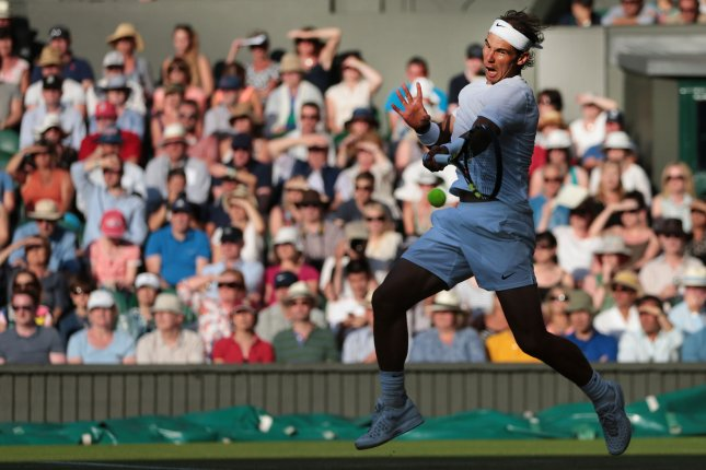 Rafa Nadal returns a ball in his match against Australian Nick Kyrgios on day eight of the 2014 Wimbledon Championships in London on July 01, 2014. Kyrgios won the match 7-6, 6-7, 7-6, 6-3. UPI/Hugo Philpott