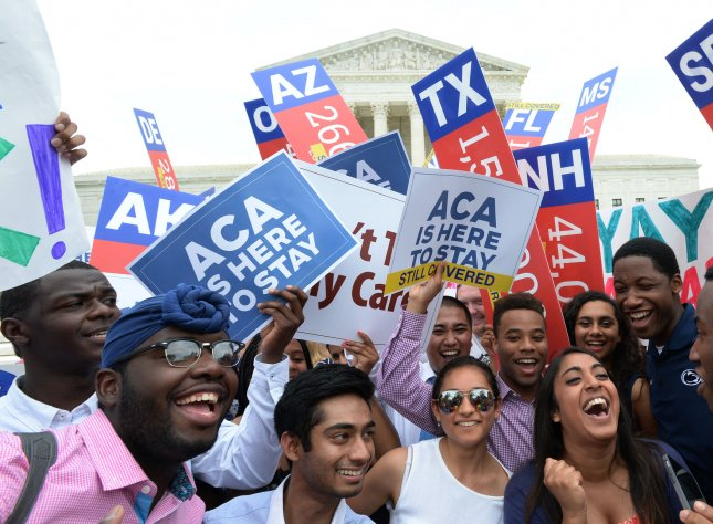 Supporters of the Affordable Care Act, known as Obamacare, are jubilant as they celebrate a 6-3 Supreme Court ruling upholding all provisions of the health care law, in front of the Supreme Court in Washington, DC on June 25, 2015. Photo by Pat Benic/UPI